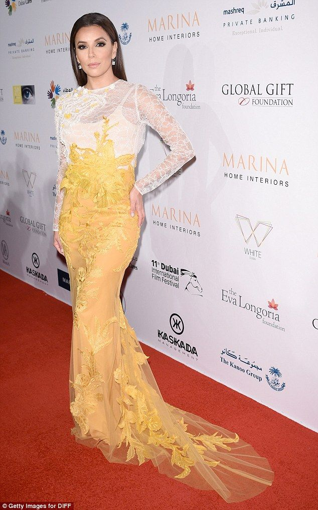 Mellow yellow Eva Longoria looked stunning in a white and yellow gown as  she arrived