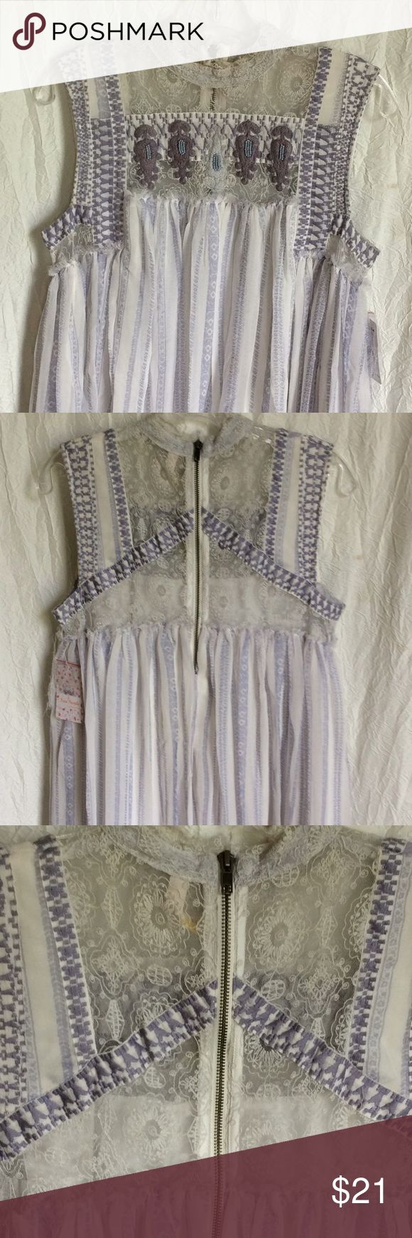 "Free People Penny Georgette Babylon Dress Sz M Free People Penny Georgette Babylon Dress.  Hard to get a picture of how free flowing the dress is.  Shades of lavender embroidery and beading on lace backed bodice.  Industrial metal zipper in back just makes the delicate look even more obvious.  Seams are sewn on outside with unfinished/raveling edges.  Item used in photo shoot and a few spots showed up (pics). Makeup on neck/slight spot on front/sticky tape on bottom Dress ress is 34"", right…"