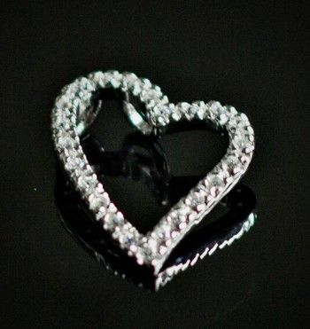A stunning sterling silver open heart pendant, set with sparkling cubic zirconia stones.