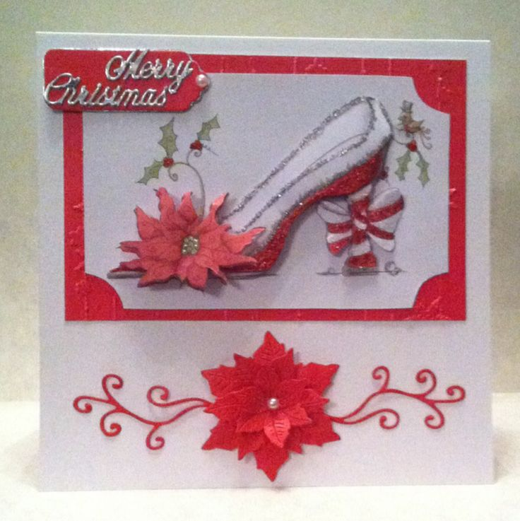 Katy Sue fabulous Christmas shoe, printed onto Matt photo paper and layered onto white cardstock. Added a bit of glitter and die cut poinsettia made using Britannia dies and flourishes made using die-namics
