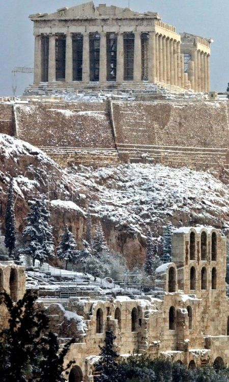 Snowy Acropolis.. Athens, Greece I would love to see some of these places in the winter.