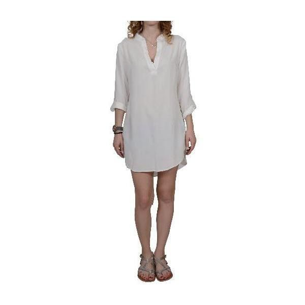 evaChic | This evaChic Charlize Roll-Up Sleeve Kaftan Tunic is a summer getaway essential you can layer over all your seasonal stunners. Featuring a V-Neck with front placket, buttoned roll-up sleeves, and curved hem with short side slits, it graces you with a roomy silhouette for lots of movement on the beach. http://www.evachic.com/product/evachic-charlize-roll-up-sleeve-kaftan-tunic/