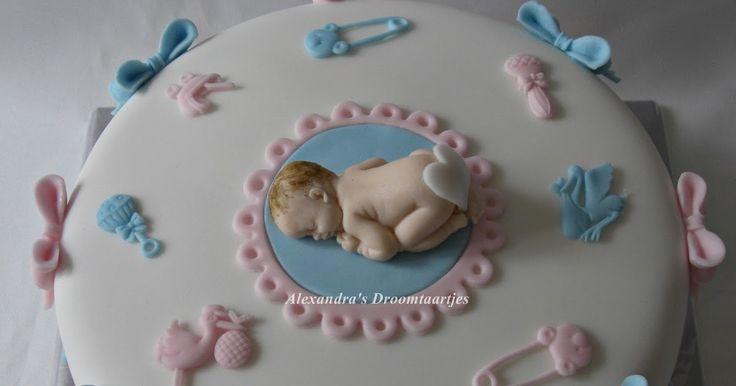Voor een baby borrel heb ik deze taart gemaakt. Omdat het geslacht nog niet bekend is zijn de kleuren zacht roze en blauw in de taart verwer...