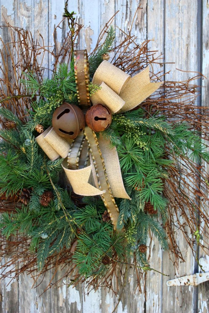 Mixed pine, burlap bow, metal ribbon, rusty jingle bells.../
