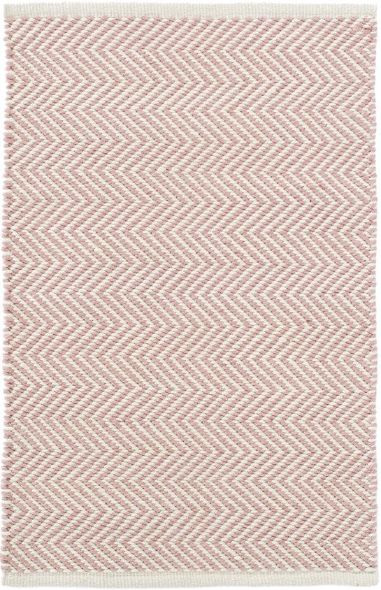 Dash & Albert Arlington Pink/Ivory Indoor/Outdoor Rug You'll love this peppy pale pink and ivory, zigzag indoor/outdoor rug! Made of thick, eco-friendly PET, this area rug is not only adorable, but also durable and easy to clean--the perfect addition to the kitchen, bathroom, kids' room, or outdoor areas. Made of 100% PET, a polyester fiber made from recycled plastic bottles. In order to achieve its rustic charm, this rug has been woven with large-diameter yarns.