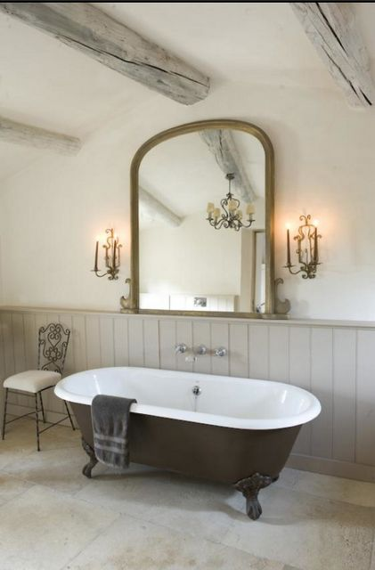 Black and white clawfoot roll top bath tub in this modern country bathroom.  If you like this pin, why not head on over to get similar inspiration and join our FREE home design resource library at http:∕∕www.TheHomeDesignSchool.com∕signup