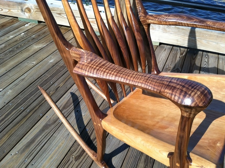 A Sam Maloof inspired rocker made of black walnut and American cherry.
