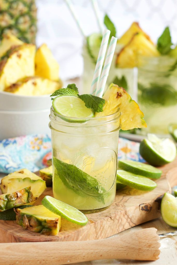 Refreshing and light, this Sparkling Pineapple Mojito recipe is what you'll be sipping all season long. The BEST summer cocktail for every party. | @suburbansoapbox