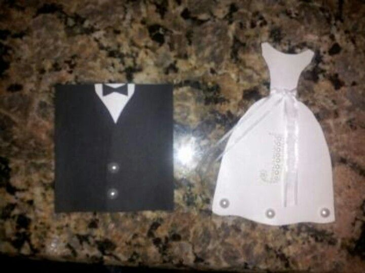 """Cards to ask my wedding party,  with the girls first initial on the front. The dress flips up and says, """"Will you be my bridesmaid/maid of honor? """" and the suit coat flaps open and says, """"will you be my groomsman/best man? """". So easy to make and it was a hit!"""