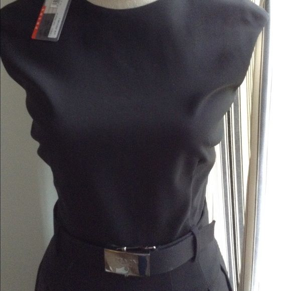 """PRADA Belted Navy Dress NWT! Deep navy sleeveless dress from PRADA. Cotton/Lycra blend which allows for some """"give"""". Silver buckle hardware with PRADA logo on the adjustable belt. Side and back zips. Pleated skirt sits just above the knee. This dress is fabulous!!!!! Italian sizing. Fits like a size 4. Prada Dresses"""