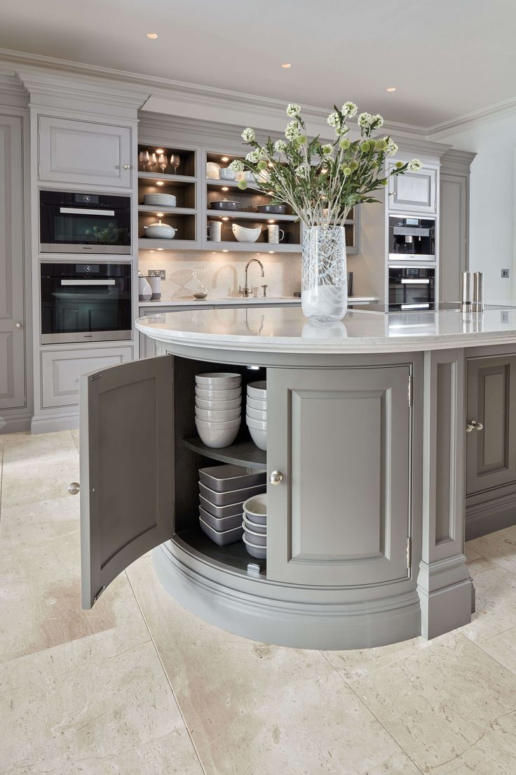 A contemporary curved grey island is a perfect addition to any modern kitchen space, oak internal storage adds a contemporary twist to a classic kitchen.