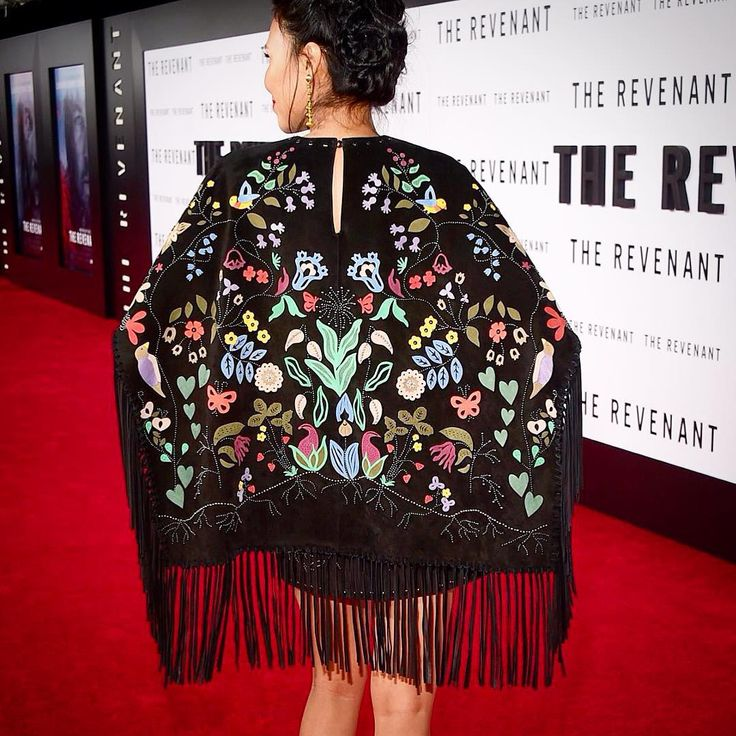 This stunning image is making its rounds on the internets, and for good reason! This is Native American actress Melaw Nakehk'o wearing a special Valentino x Christi Belcourt dress to the Hollywood premiere of The Revenant last night! Nakehk'o, who is Dene and originally from Fort Simpson, N.W.T., plays a character named Powaqa, and acts alongside one of my all-time fave actors Leonardo DiCaprio!