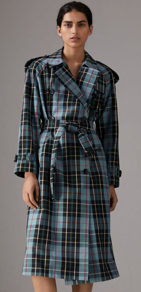 A #Burberry trench coat in tartan cotton gabardine, woven for protection at the Burberry mill in Yorkshire. The relaxed cut has a pronounced storm shield and inverted box pleat at the back for volume.