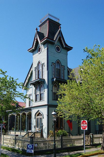Victorian with a tower, round windows, and a beautifully unique rooftop. Hard to clear off in the winter?