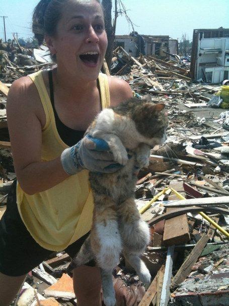 (after Joplin tornado woman finds her cat alive in home's debris 16 days later.  Imagine the joy she felt in her heart when she found her friend)