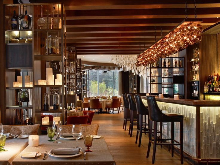 """Lighting in the Il Lago dei Cigni Restaurant in St. Petersburg orchestrates a """"Swan Lake"""" of light born from the fragile beauty of Russian nature and entirely natural materials. #light #lighting #design #designlighting #interior #chandelier #hospitality #hotel #restaurant #restaurantlightingideas"""