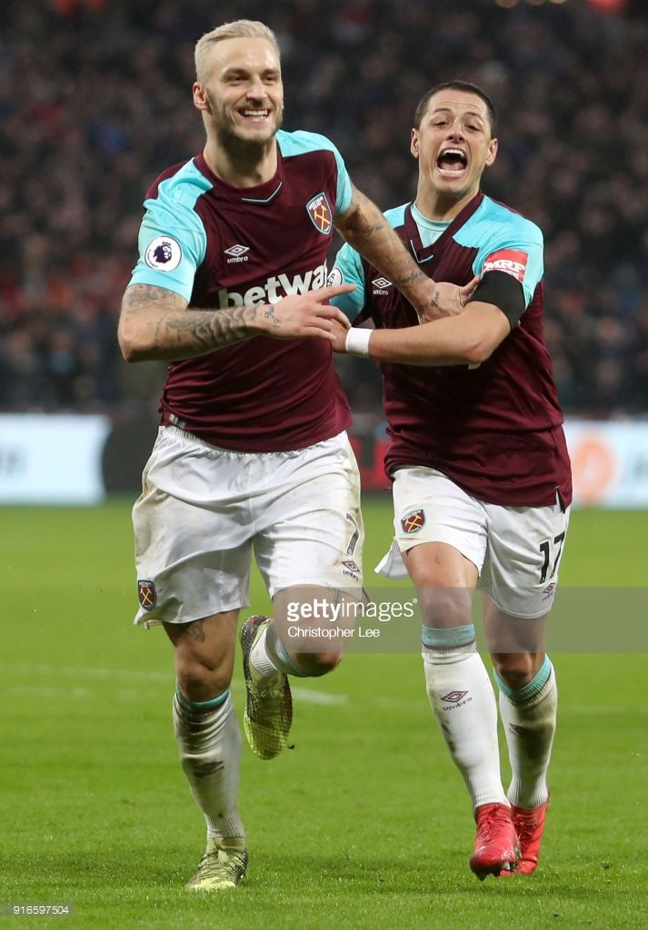 Marko Arnautovic of West Ham United celebrates with teammate Javier Hernandez after scoring his sides second goal during the Premier League match between West Ham United and Watford at London Stadium on February 10, 2018 in London, England.
