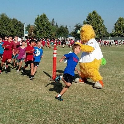 Parker encouraging kids at Century Elementary's Jog-A-Thon