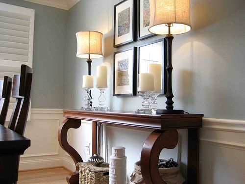 Paint color Benjamin Moore Iced Marble, trim and wainscoting Sherwin Williams Alabaster, console Ballard Designs, lamps from Homegoods, candles Pottery Barn Outlet