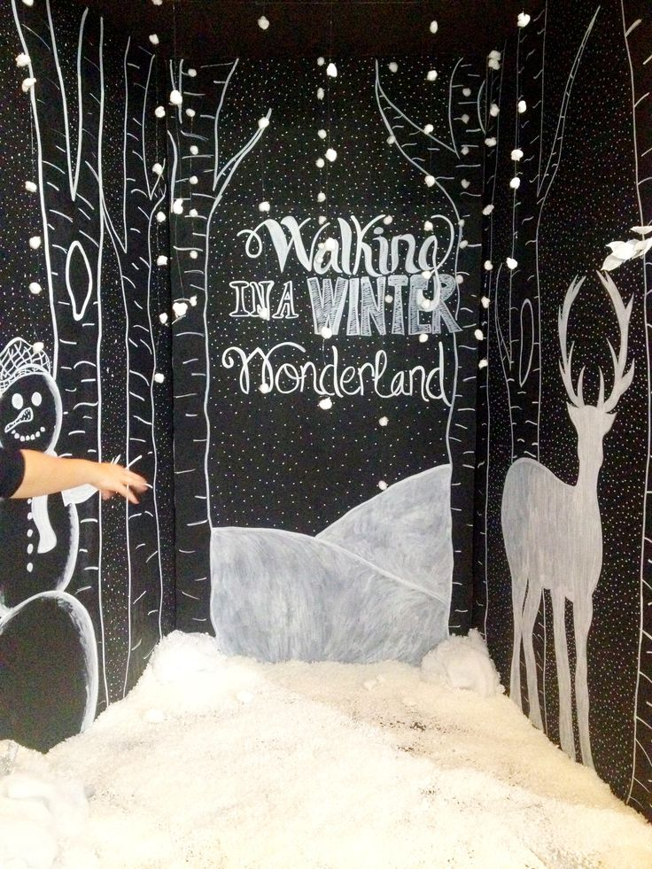 Winter wonderland photobooth. Painted black. Freehand chalk art. Cotton balls on fishing line = floating snow. Mix of shredded styrofoam pieces, potato flakes, and glitter = snow on ground