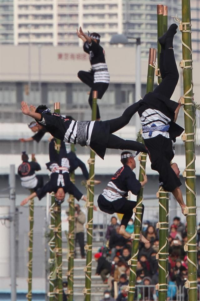 Tokyo Fire Department showcasing Hashigonori, traditional ladder acrobatics of the Edo period (1603-1868) fire fighters. This was part of the New year ceremony held at Tokyo Big Sight in Koto Ward, Tokyo // Photo Sankei MSN