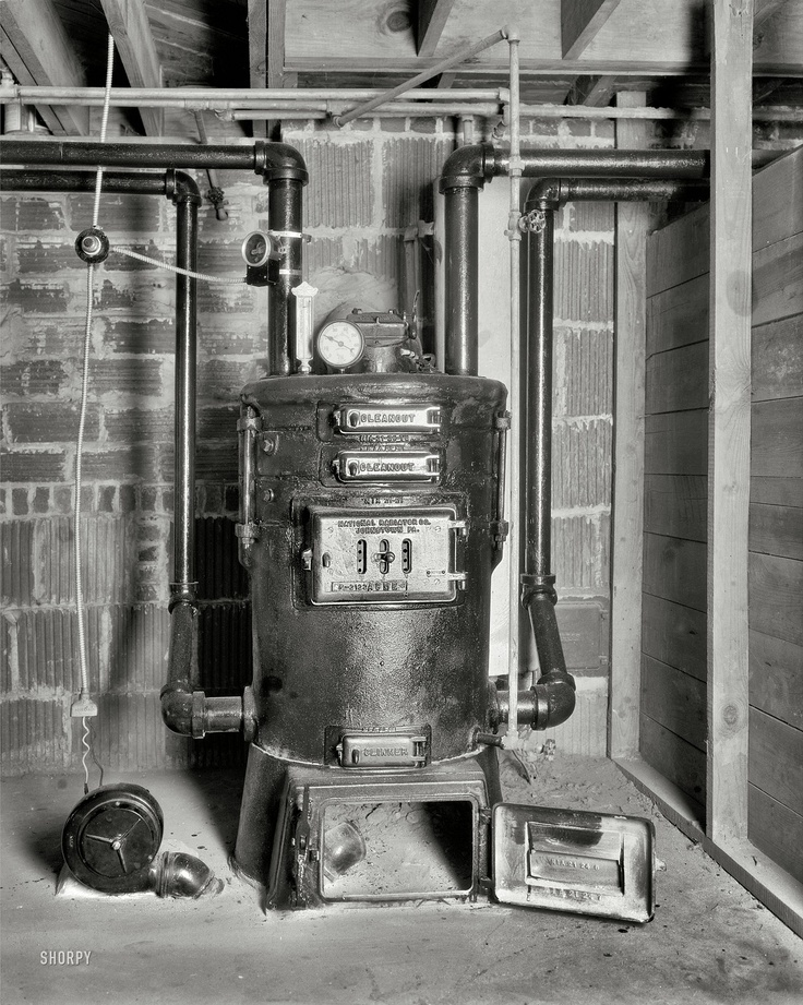Neat old coal boiler or furnace.  it even has an electric blower to feed air to it. pretty high tec and just plain neat!