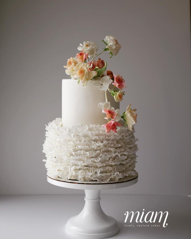 Maim Cake in Columbus Ohio. A ruffled first layer with sugar flowers. Just stunning!