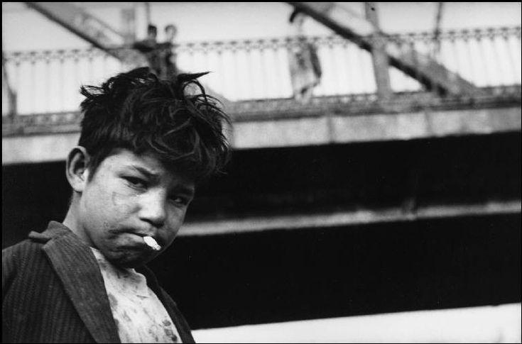 Sergio Larrain - Magnum Photos    Children living around the Mapocho river and sleeping under bridges.