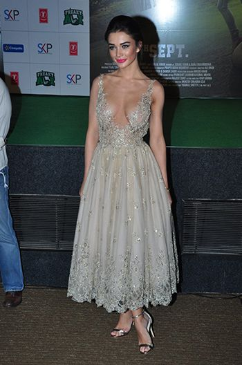 Amy Jackson in a dress by Paolo Sebastian.