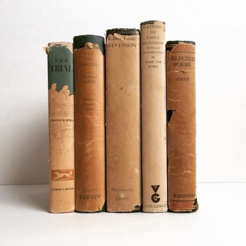 """macrolit:  """"Beautifully aged hardcovers with dust jackets  The Trial, Jude the Obscure, Robert Louis Stevenson, Letters of Emily Dickinson, Selected Poems of Conrad Aiken  """""""