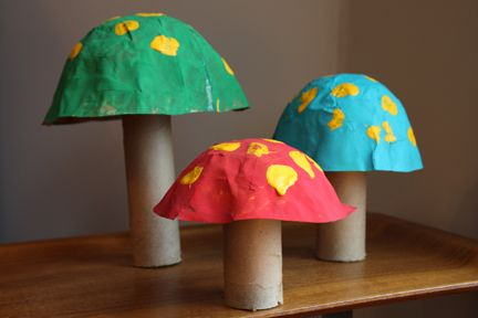 We made some recycled decorations like the mushrooms pictured above. These were made with the same technique I used making the Halloween bowls and I cut a fabric bolt for the stems. Then my daughter painted them. We also used cardboard fabric tubes for giant candy cane sticks by covering them in butcher paper and wrapping them with red velvet ribbon.