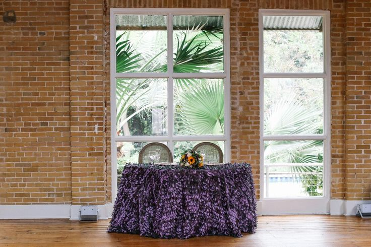 Our sweetheart table by Marquee Rentals in San Antonio - purple, beige and sunflower wedding