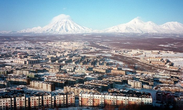 One of the most remote cities in the world ... Two active volcanoes loom over the Russian city of Petropavlovsk-Kamchatsky.