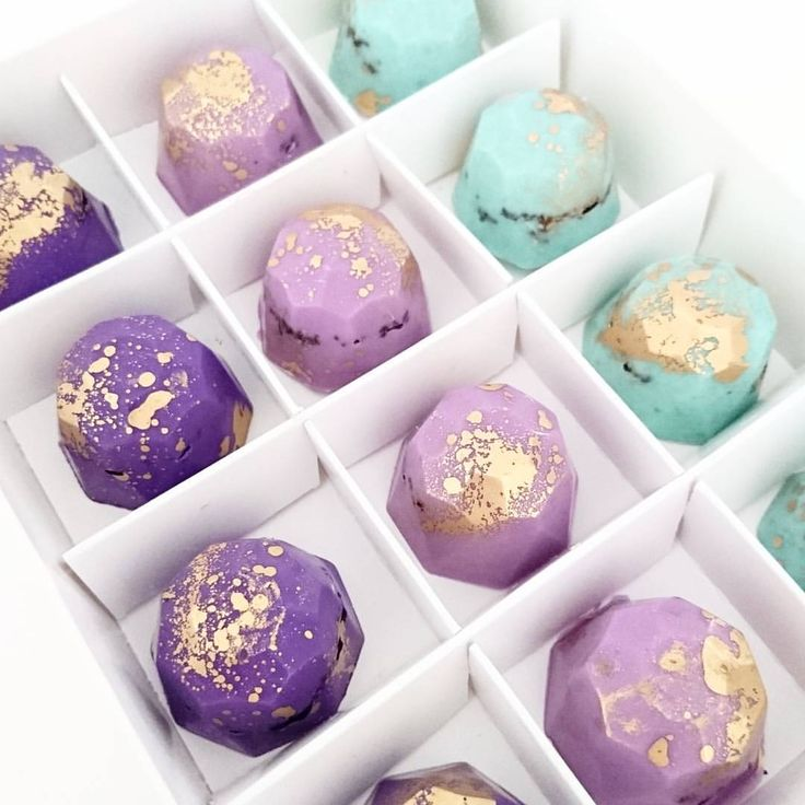 "NOW AVAILABLE TO ORDER ONLINE 12 x Chocolate Gems presented in white gift box. ""EMPRESS"" colour pallette: violet, lilac and pastel mint green. Filled with crushed chocolate cookie and flecked with gold.  Order in advance and pick up from per kitchen in Castle Hill."