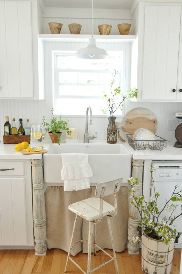 LOVE the farmhouse sink! And the columns that hold the end of the countertops! And the curtain's not a bad idea.
