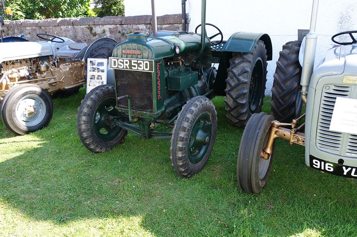 green Standard Fordson tractor, 1940 beside Ferguson 35
