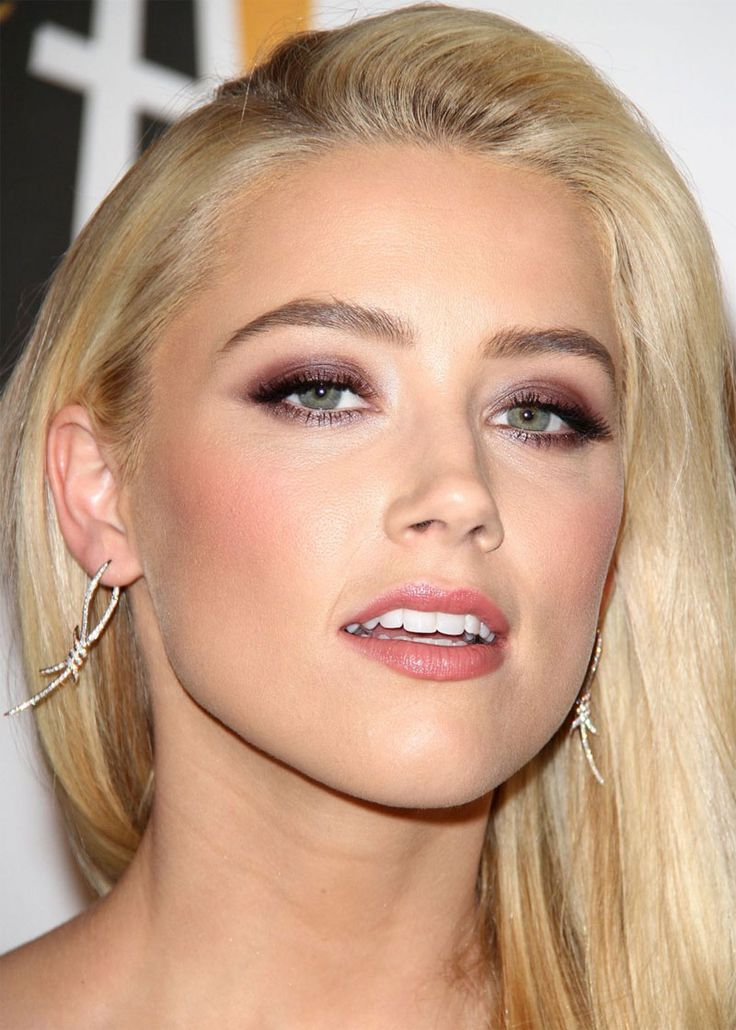 Engaging Amber Heard ...Beautiful celebrities... A fan of muscle cars, she drives a 1968 Ford Mustang.