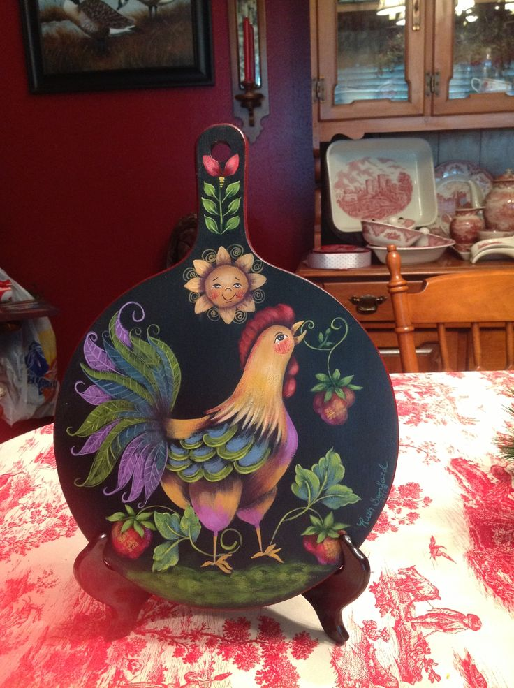 Bread board painted with a Rosemary West design for Lisa.