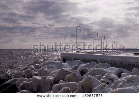 The winter is coming ;) Pier in cold winter with icy stones. by ANOVVA.EU, via ShutterStock
