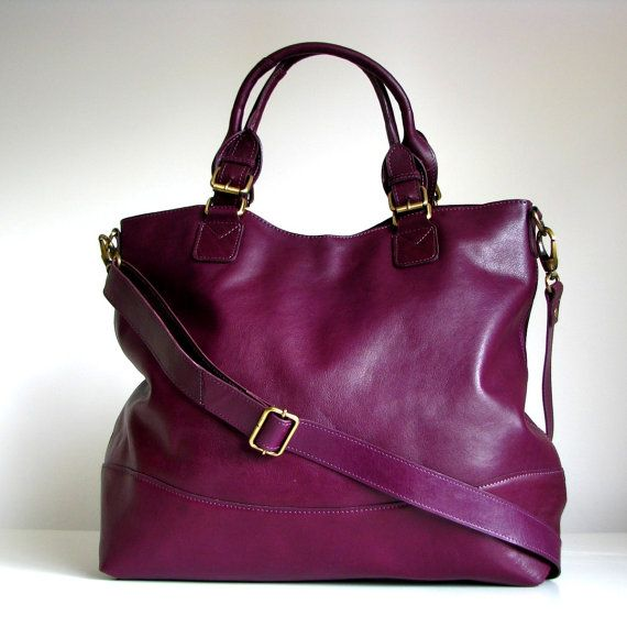 A large leather classic tote handbag in a beautiful purple shade. Made from thick supple leather with a slight grain, this design is a timeless