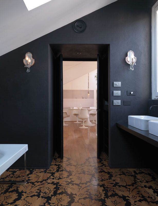 partially painted parquet and black walls