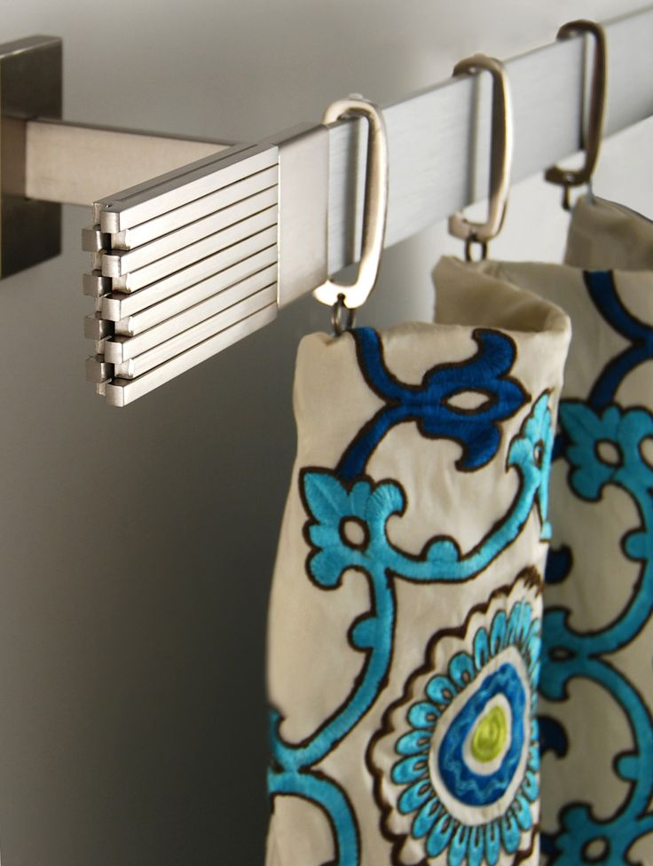 Beautiful silk fabric paired with modern drapery hardware by Brimar. #brimar