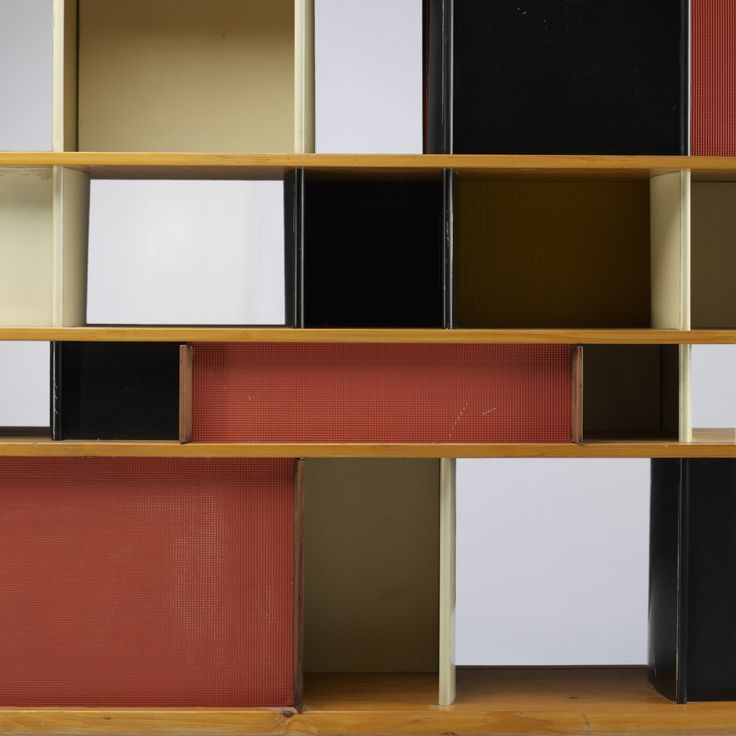 CHARLOTTEPERRIAND  Bibliothèque from the Maison duMexique    Ateliers Jean Prouvé and AndréChetaille  France, 1952  solid pine, enameled steel, enameled aluminum, mahogany