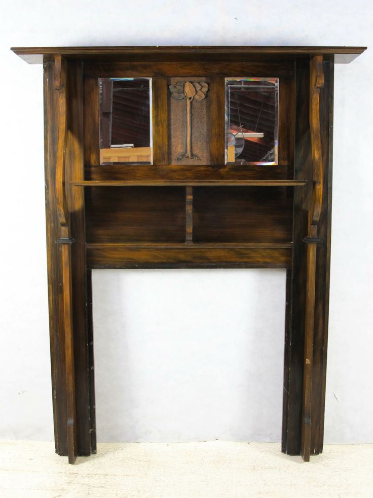 Amazing Timber Mantle Piece Stock #5703 1320 w x 1915 h Hole size - 920 w x 930 h Ledge - 1510 w Original kauri pine ( unpainted & oiled ) 2 bevelled edge mirrors This is one our our best !