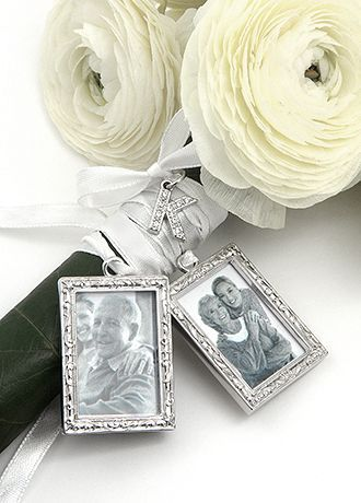 """They say a picture is worth a thousand words This set of 2 photo charms is elegantly crafted and each hangs from a beautiful satin ribbon to tie to your bouquet. Select one jeweled letter charm to personalize this elegant charm set.; Features and Facts: Frame size: 1.5"""" x 1"""" Holds picture size of 1"""" x 1.38"""" Silver tone frame hosting boarders with a decorative textured trim Ribbon width 1/8"""" Ribbon length 26""""; Total length tied with ribbon 11"""" Personalize with single initial"""