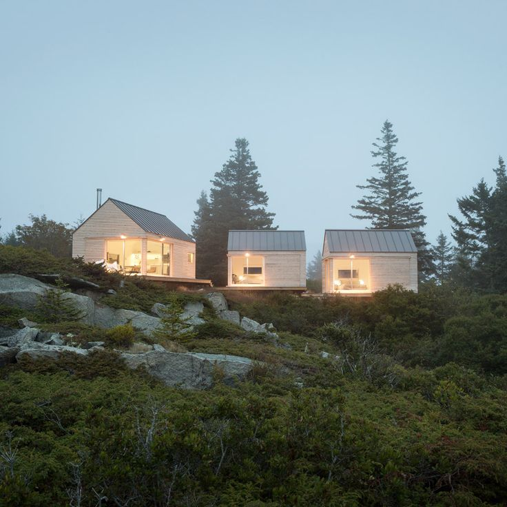 This summer house on the rocky coastline of Maine made up of three wooden cabins