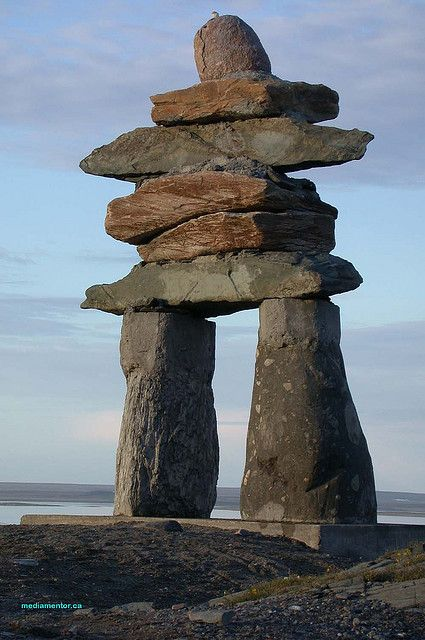 The compelling Inukshuk (a traditional sculptural form of unworked stone made & used by the Inuit people for communications & survival purposes....the word means in likeness of )  as photographed in Nunavut Canada by George Lessard. This  is pretty cool ! Would love to see it in person.....