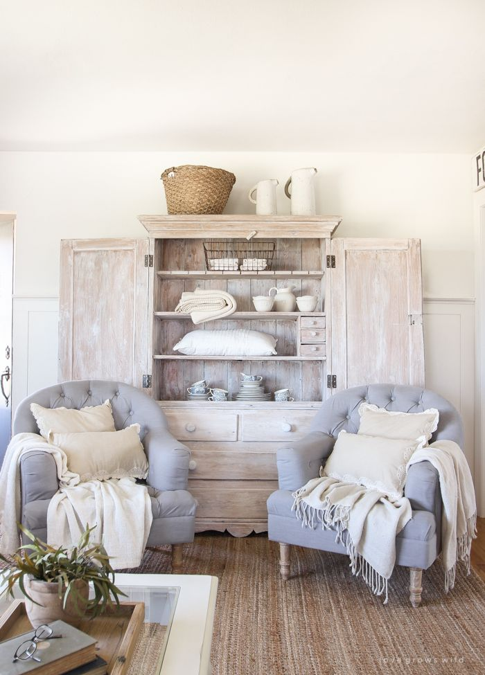 An antique hutch styled simply but beautifully in this Indiana farmhouse