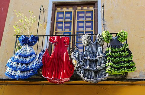 "Mingle among the colorful ""farolillos"" and traditional flamenco dress in a private caseta at the Feria de Abril in Sevilla. http://bit.ly/1jQDxhf"