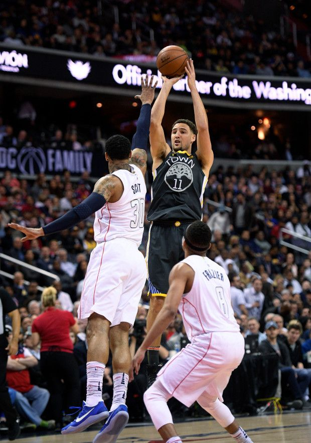 a47b0dea44e2 Golden State Warriors guard Klay Thompson (11) shoots over Washington  Wizards forward Mike Scott (30) and guard Tim Frazier (8) during the first  half of an ...